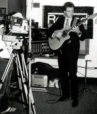 Patxi plays an Ovation guitar and Roland digital sampler that he designed, which produces whale and dolphin vocalizations, 1983.